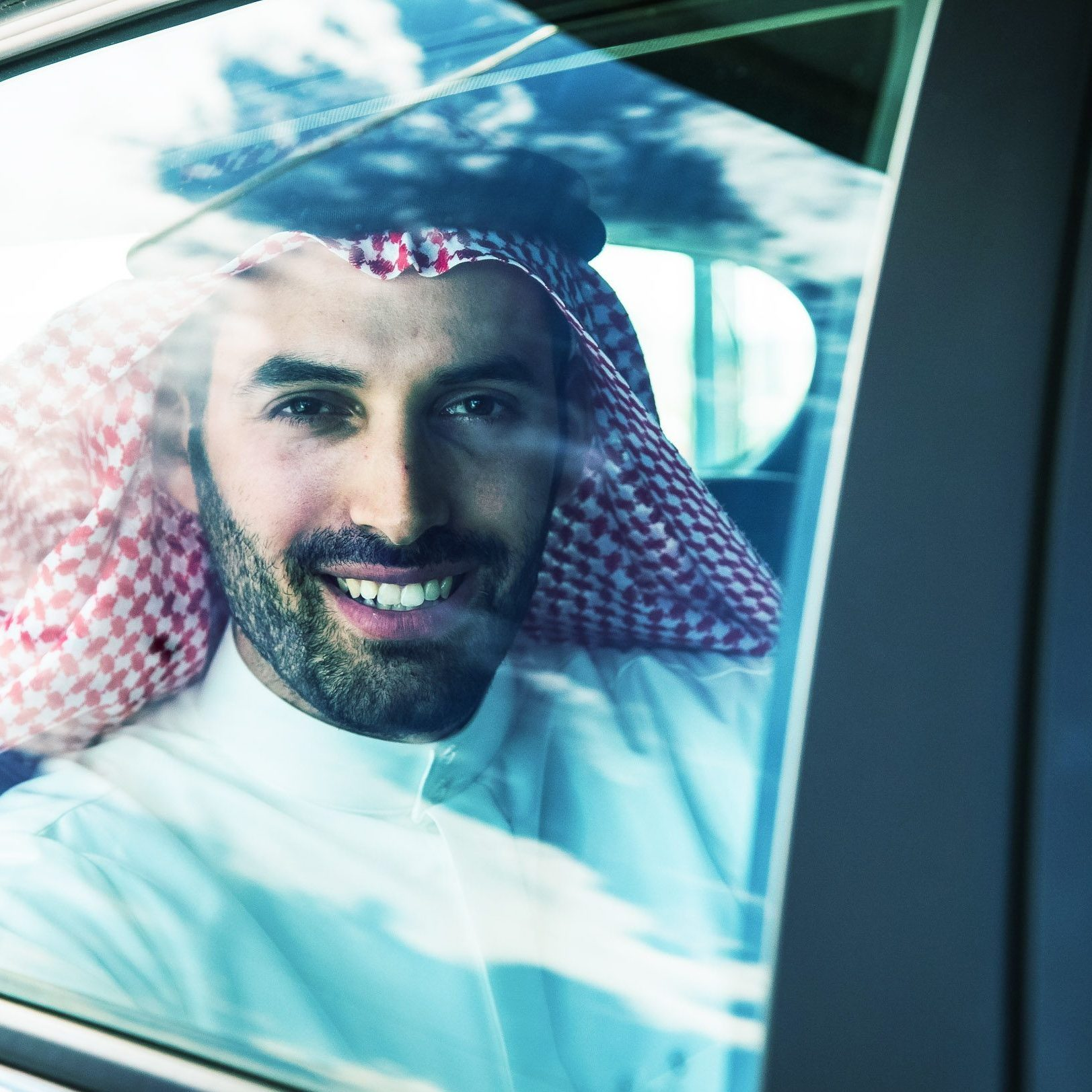 Man from Saudi looking out car window